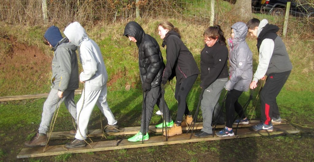 Young Leaders practice working together to 'Walk the Plank' during a development weekend at the Maes y Lade Centre in Wales